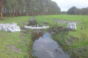 A small temporary bund was used to keep the flowing water out of our way while we prepared the base...