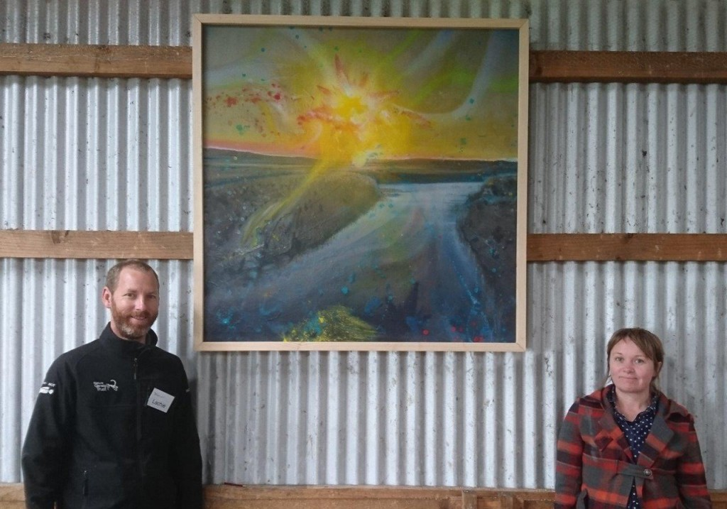 Cross Border curator and artist Megan Nicolson (right), with partner and NGT Senior Wetland Ecologist Lachlan Farrington - photographed here with one of the larger artworks that featured in the exhibition.
