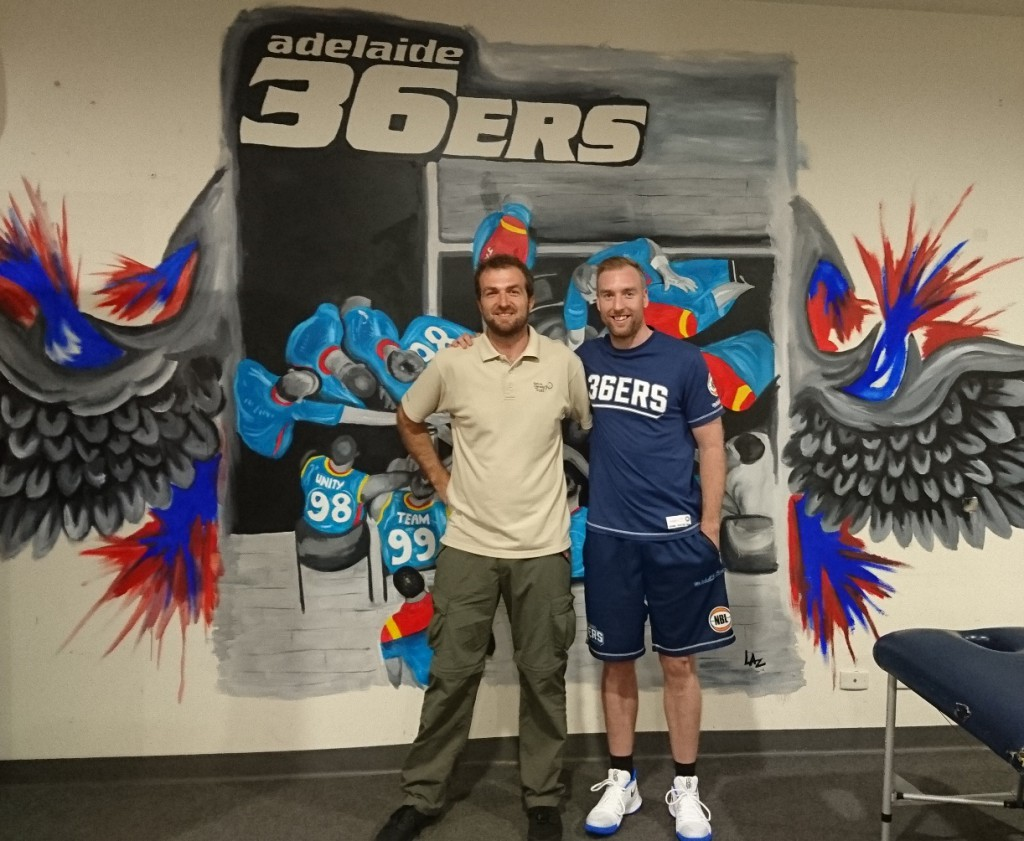 NGT's Mark Bachmann with Adelaide 36ers captain Brendan Teys after the CEP shoot-out in the team rooms.