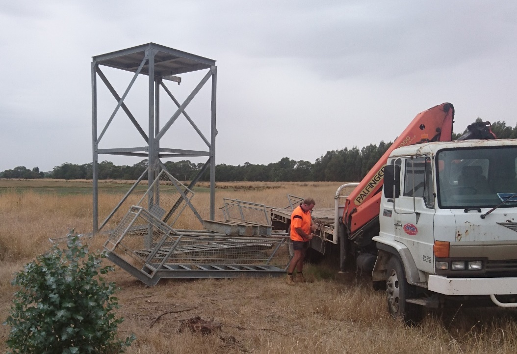 Jason finishes unloading the tower parts at Walker Swamp